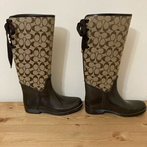 Coach women's brown Tristee lace up boots